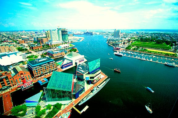 Baltimore's Inner Harbor is seen from above on a clear summer day.