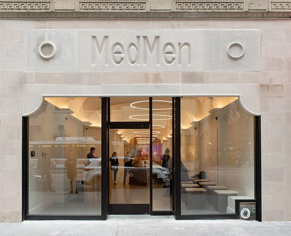 A front-on shot of MedMen's fancy marble entrance to their NYC flagship store on 5th Avenue.