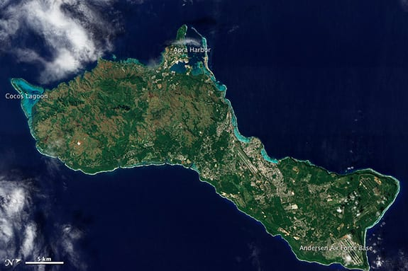 The island of Guam is seen overhead in a satellite photo.