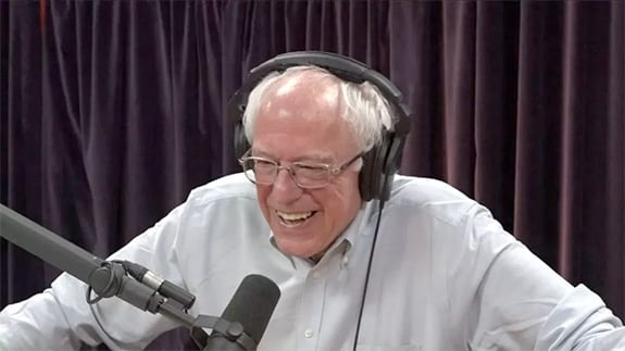 Vermont Senator Bernie Sanders smiles while appearing on the Joe Rogan podcast.