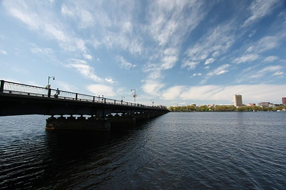 A bridge crosses the Charles River in between Boston and Cambridge Massachusetts.
